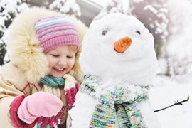 Europe Holidays - Finland, Lapland - Happy child with snowman