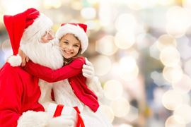Europe Holidays - Finland, Lapland -  smiling little girl hugging with santa claus