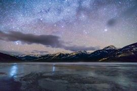 Canada Holidays - sky full of stars, green moon and  canadian landscapes