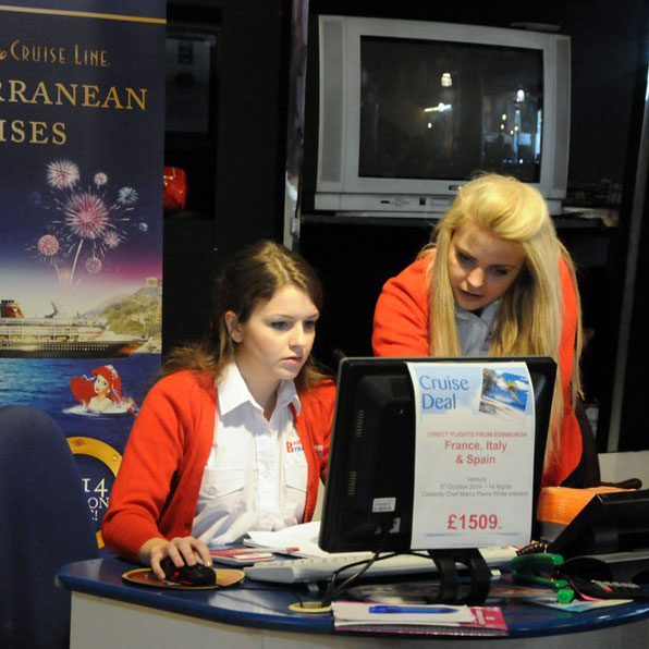 barrhead travel staff at a computer
